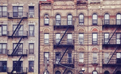 Old buildings with fire escapes in New York City.