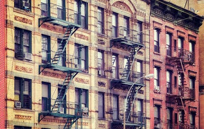 Old buildings with fire escapes, NYC.