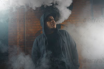 Man in a cloud of white vapour fume