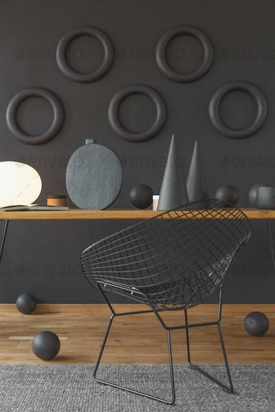 Black chair in artist's workspace