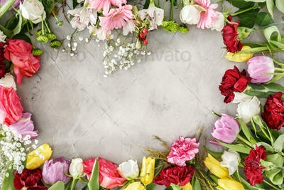 Colorful flowers on gray table