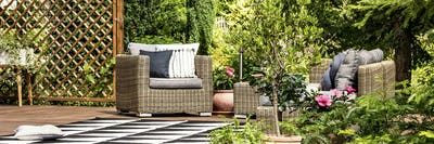 Garden armchair with pillows