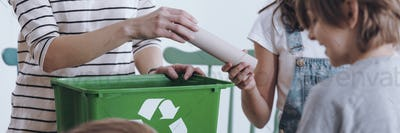 Girl recycling paper tube
