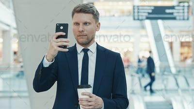 Young businessman making a photo