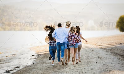 Group of happy young people having fun on beach