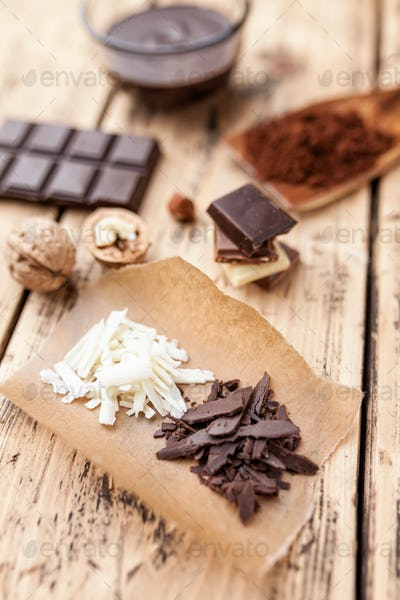 Delicious chocolate on wooden background