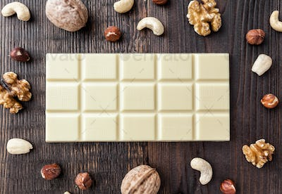 Delicious white chocolate on wooden background