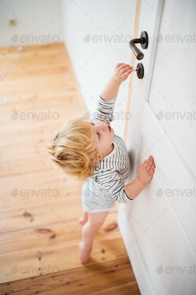 Toddler child in a dangerous situation at home.