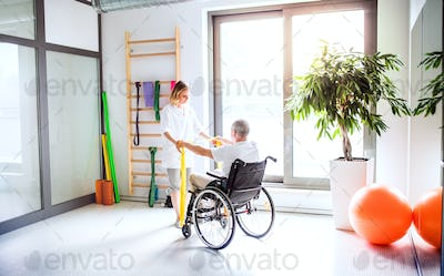 Young woman physiotherapist working with a senior man in wheelchair.
