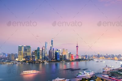 shanghai skyline against a rosy sky in nightfall