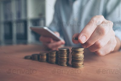 Coin stacker, businessman with stacked money
