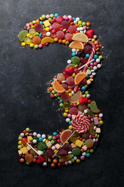 Number three made from candies