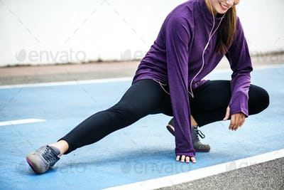 White woman stretching before exercise
