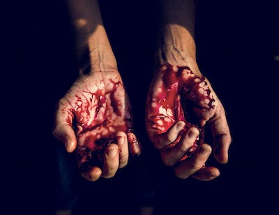 Bloody hands with black background
