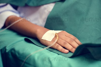 Closeup of hand with IV tube