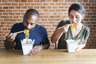 Couple eating Chow mein together