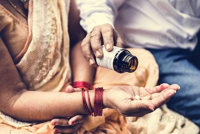 Indian people taking medicines