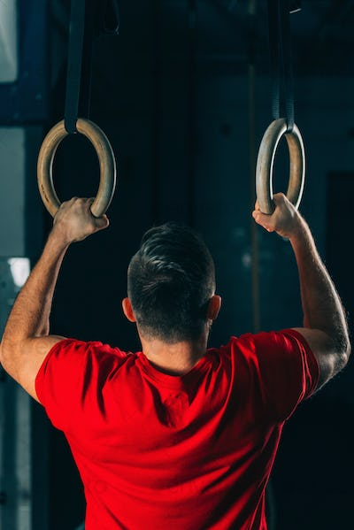 Cross training. Gymnastic rings exercising