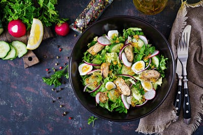 Dietary salad with mussels, quail eggs, cucumbers, radish and lettuce.