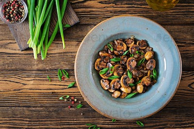 Baked mushrooms with soy sauce and herbs. Vegan food. Top view