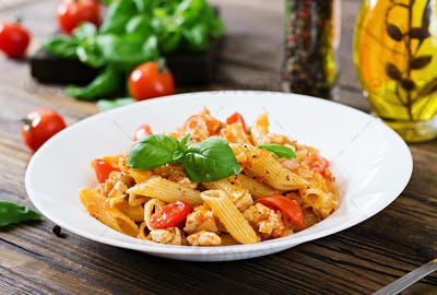 Penne pasta in tomato sauce with chicken,