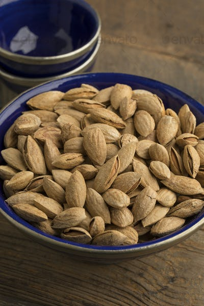 Fresh unpeeled almonds  in a bowl