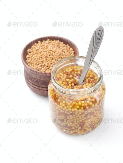 mustard dijon sauce in jar on white