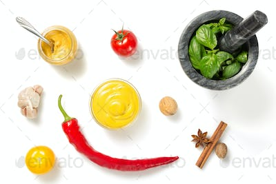 set of dip sauces and spices  on white