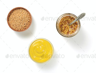 mustard sauce in bowl on white background