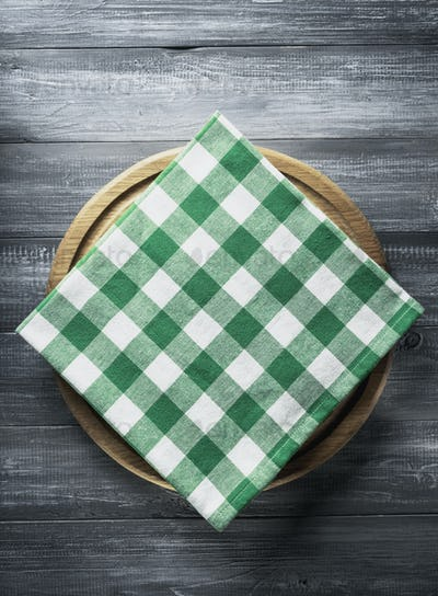 napkin and board on wooden background