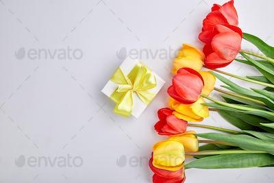 White gift box with yellow ribbon