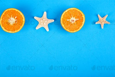 Summer concept. Orange fruit and starfish
