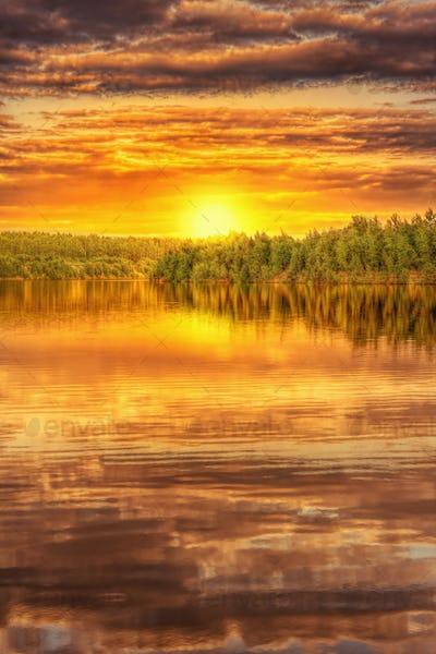 Sunset on the shore of beautiful lake