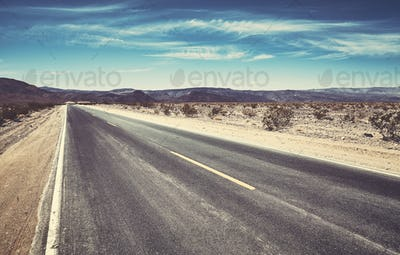 Picture of an empty desert road.