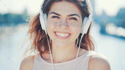 Happy smiling girl listen to music