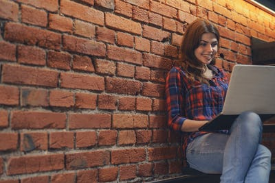 Young attractive woman with laptop