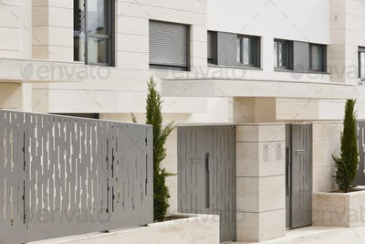 Modern residential building entrance. Estate property. Marble stone. Construction. Horizontal