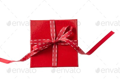 Red gift box isolated on white background, top view