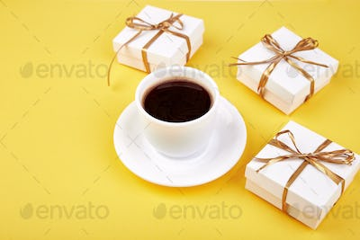 White gift box with gold ribbon