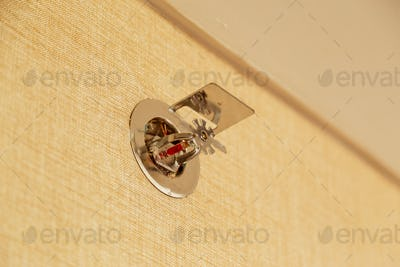 Fire sprinkler on a wall, fire emergency