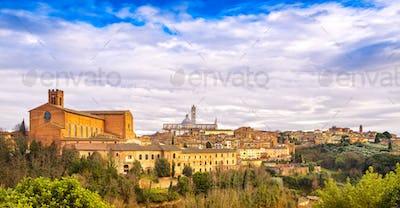 Siena sunset panoramic skyline. San Domenico and Duomo cathedral