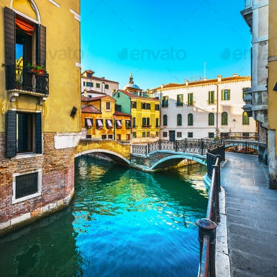 Venice cityscape, buildings, water canal and double bridge. Ital