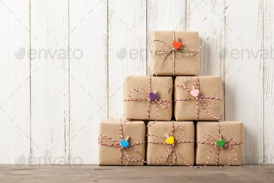 Wrapped gift boxes on wooden table