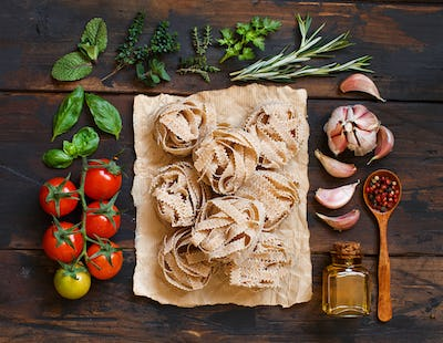 Whole wheat pasta tagliatelle, vegetables and herbs