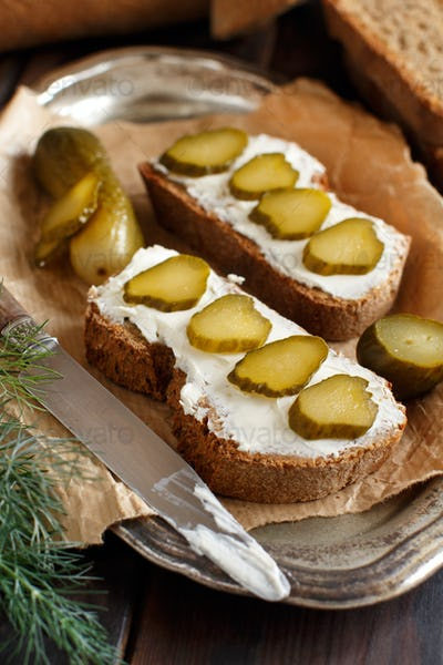 Sandwiches with cream cheese and salted cucumber