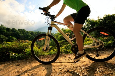 Riding mountain bike on forest trail