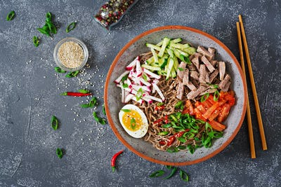 Buckwheat noodles  with beef, eggs and vegetables. Korean food