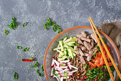 Buckwheat noodles  with beef, eggs and vegetables. Korean food.