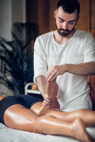 Therapist Doing Anti Cellulite Madero Therapy Massage