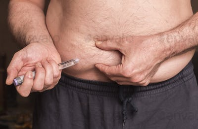 Man with diabetes will prick insulin in the belly, image conceptual